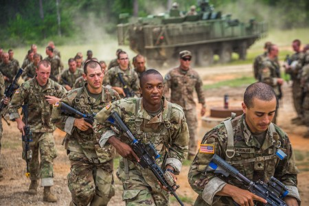 Trainees from the 50th Infantry Regiment at Fort Benning, Ga., conduct urban operations training, July 13, 2018.  Soldiers practiced clearing rooms, securing courtyards and moving between buildings in a complex urban environment while utilizing Infantry carrier vehicles to enhance the training experience.