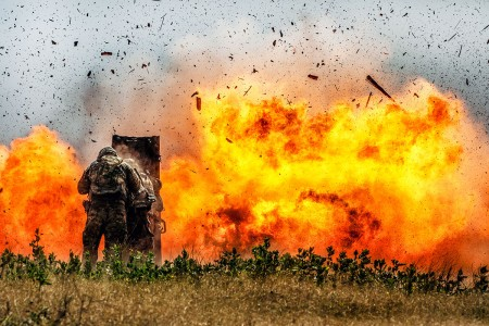 Combat engineers from the 2nd Armored Brigade Combat Team, 1st Cavalry Division, blast through a concrete wall during demolition training at Fort Hood, Texas, July 17, 2018.