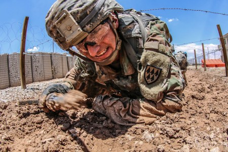 Competitors charge their way through the Medical Training Simulation Center's qualification lane on the second day of the week long Black Jack Warrior Competition at Fort Bliss, Texas, July 16, 2018.