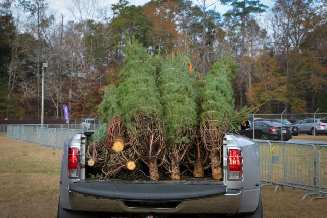 FORT BENNING, Ga. (Dec. 7, 2018) -- Soldiers and their Families receive free Christmas trees today on Wetherby Field here. In its 14th year, the trees were donated by FedEx with greetings on tags from across the country as a way of saying thanks to those who protect our freedom. (U.S. Army photo by Markeith Horace, Maneuver Center of Excellence, Fort Benning Public Affairs)