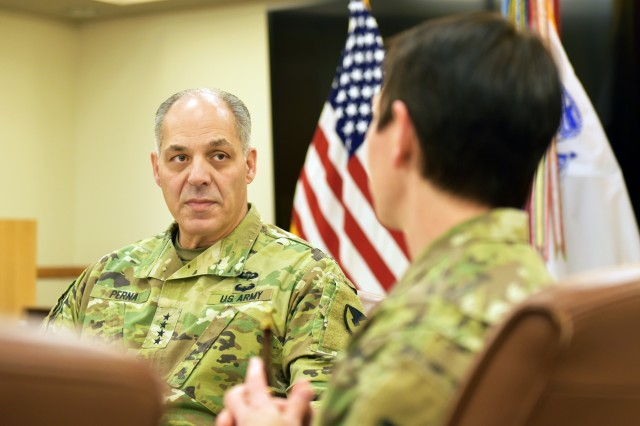 Gen. Gus Perna, U.S. Army Materiel Command Commanding General and the Army's senior logistician, visits with leaders from the U.S. Army Medical Research and Materiel Command at Fort Detrick in Frederick, Maryland Dec. 7.