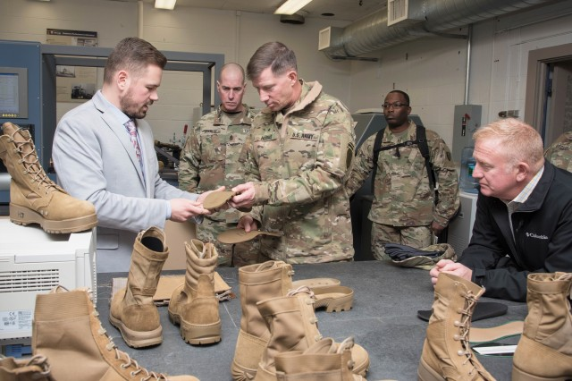 Brigadier General David M. Hodne, commandant of United States Army Infantry School at the Army Maneuver Center of Excellence, in Ft. Benning, Georgia, and director of the U.S. Army's Soldier Lethality Cross Functional Team, is briefed on different types of combat boots inside the Footwear Performance Lab by Albert Adams, a footwear project engineer for the U.S. Army Research Development and Engineering Command Soldier Center during a recent visit to the Natick Soldier Systems Center in Natick, Mass., in order to learn more about recent efforts in technology development and human performance optimization.