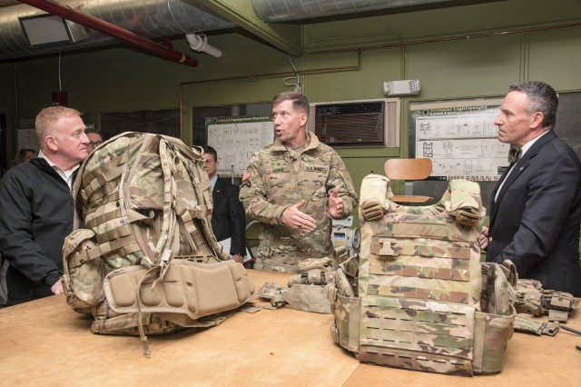 Brigadier General David M. Hodne, commandant of United States Army Infantry School at the Army Maneuver Center of Excellence, in Ft. Benning, Georgia, and Director of the U.S. Army's Soldier Lethality Cross Functional Team, is briefed on load carriage efforts, including a new prototype rucksack by Rich Landry, a load carriage equipment specialist for the U.S. Army Research Development and Engineering Command Soldier Center during a recent visit to the Natick Soldier Systems Center in Natick, Mass., in order to learn more about recent efforts in technology development and human performance optimization.