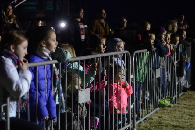 FORT BENNING, Ga. (Dec. 10, 2018) - Children watch a demonstration at the annual 250-foot tower lighting at Eubanks Field. Families from across Fort Benning and the Chattahoochee Valley community gathered for a Benning holiday tradition Dec. 8 on Eubanks Field here. (U.S. Army photo by Megan Garcia, Maneuver Center of Excellence, Fort Benning Public Affairs)