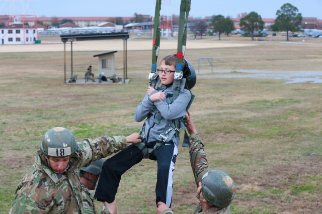 FORT BENNING, Ga. (Dec. 7, 2018) -- Soldiers, Family and friends gather for the annual 250-foot tower lighting on Eubanks Field. Family and friends tested their airborne skills by jumping from a 34-foot training tower to simulate a parachute drop, while other patrons enjoyed the festive holiday tunes courtesy of the Maneuver Center of Excellence. (U.S. Army photos by Markeith Horace, Fort Benning Maneuver Center of Excellence photographer)