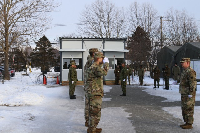 Soldiers from America's First Corps and the Japan Northern Army participate in a bilateral flag raising during Yama Sakura 75 at Camp Higashi-Chitose, Japan, Dec 11, 2018. American and Japanese forces raised the flags in unison to represent the teamwork involved in the exercise. Yama Sakura is a joint training exercise that strengthens America's alliance with the Japan Ground Self Defense Force and commitment to assisting in keeping the region secure. U.S. Army photo by Sgt. Erica Earl