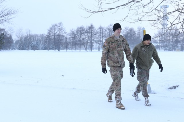 Capt. William Dudley, a field artillery officer with America's First Corps and Pvt. First Class Edward Williams, a fire control specialist with I Corps, walk through the snow before the kickoff of Yama Sakura 75 at Camp Higadashi Chitose, Japan, Dec 7, 2018. Yama Sakura is a bilateral command post exercise with the Japan Ground Self-Defense Force in which U.S. and Japanese forces exchange ideas, techniques, military experience and exercise capabilities in defense of Japan. The exercise highlights the strength of the close, long-standing relationship the United States has with Japan and the JGSDF. U.S. Army photo by Sgt. Erik Warren
