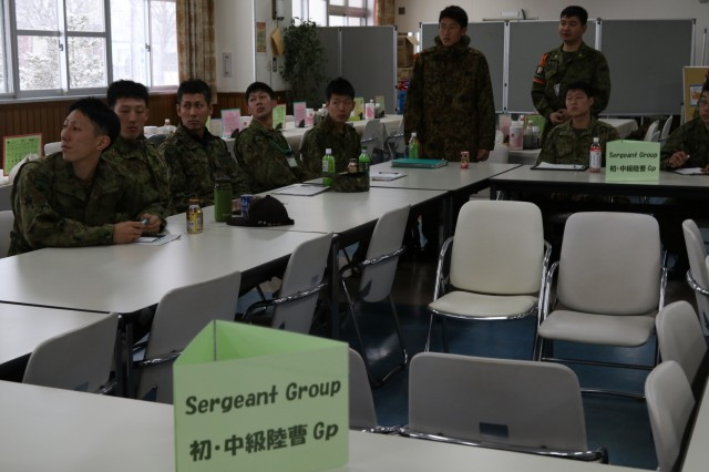 U.S. Army and Japan Ground Self-Defense Force noncommissioned officers discuss similarities and differences between the two Armies in a cultural exchange before the kickoff of Yama Sakura 75 at Camp Higashi Chitose, Japan, Dec 6, 2018. Yama Sakura is a bilateral command post exercise with the Japan Ground Self-Defense Force in which U.S. and Japanese forces exchange ideas, techniques, military experience and exercise capabilities in defense of Japan. The exercise highlights the strength of the close, long-standing relationship the United States has with Japan and the JGSDF. U.S. Army photo by Sgt. Erica Earl