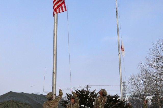 Soldiers from America's First Corps and the Japan Northern Army raise their respective nations' flags in a ceremony during Yama Sakura 75 at Camp Higashi-Chitose, Japan, Dec 11, 2018. American and Japanese forces raised the flags in unison to represent the teamwork involved in the exercise. Yama Sakura is a bilateral training exercise that strengthens America's alliance with the Japan Ground Self Defense Force and commitment to assisting in keeping the region secure. U.S. Army photo by Sgt. Erica Earl