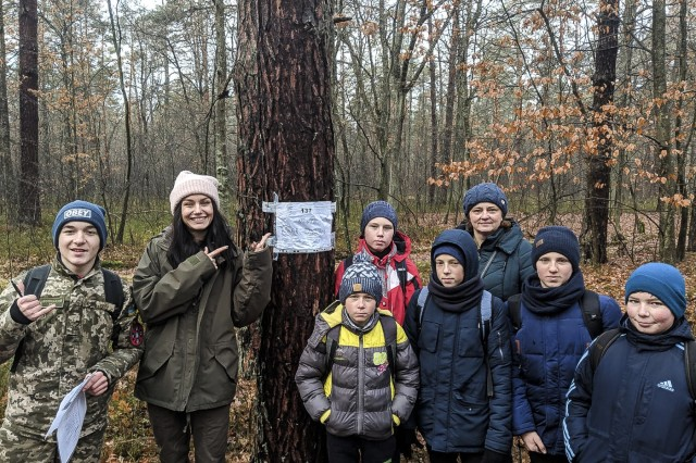 The Boys and Girl Scouts team up to run a land navigation course in the International Peacekeeping and Security Center, Ukraine, Dec. 9.