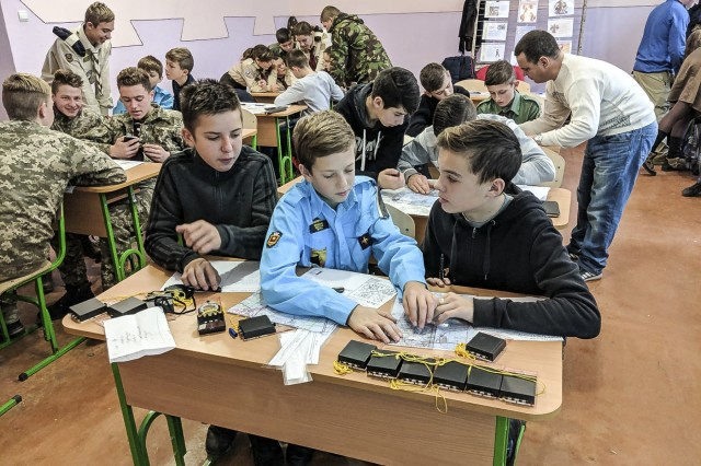 Boys and Girls Scouts take a class on land navigation taught by U.S. and Ukrainian Service members held at the  International Peacekeeping and Security Centre, Ukraine, Dec. 9.