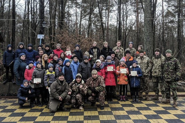 Group photo of the Boy and Girl Scouts and U.S. and Ukrainian service members at the  International Peacekeeping and Security Centre, Ukraine, Dec. 9.