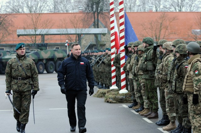 Andrzej Duda, the president of Poland, conducts a pass and review on the parade field during the closing ceremony of ANAKONDA 18 at the Headquarters Multinational Division - North East in Elblag, Poland, Dec. 6, 2018. AN-18 is the largest, periodic joint exercise organized by Poland. (U.S. Army National Guard photo by Sgt. 1st Class Craig Norton, 382nd Public Affairs Detachment/Released)