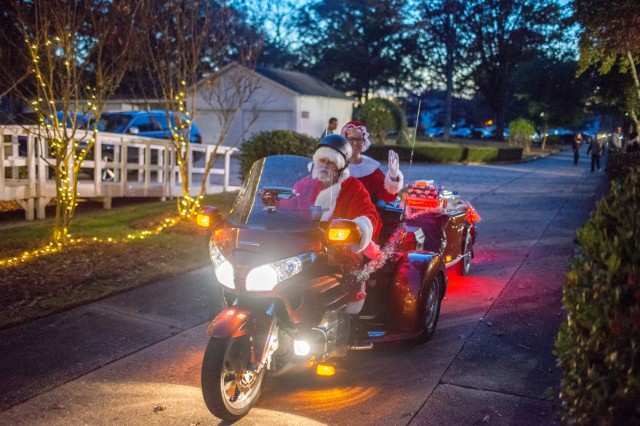 FORT BENNING, Ga. (Dec. 11, 2018) -- Members of the Fort Benning, Georgia, community kick off the holiday season with the annual Santa at Riverside event Dec. 6, 2018, at the home of the Maneuver Center of Excellence commanding general, Maj. Gen. Gary M. Brito. During the event, the Fort Benning Christmas tree was illuminated, Santa took photos with children in attendance and gifts were raffled out to various Families. (U.S. Army photo by Patrick Albright, Maneuver Center of Excellence, Fort Benning Public Affairs)