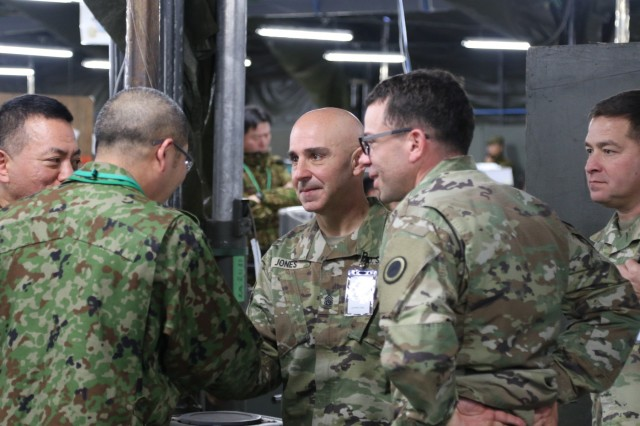 Command Sgt. Maj. Benjamin Jones, United States Army Pacific Command Senior Enlisted Advisor (third from right), greets Sgt. Maj. Takatoshi Kawase (second from left) from the Japan Northern Army, Dec. 11, 2018 during his visit to Camp Higashi-Chitose on Hakkaido, Japan.Jones met with Northern Army Soldiers from the Japan Ground Self Defense Force, Soldiers from America's First Corps, and United States Army Japan during his visit in support of Exercise Yama Sakura 75.Yama Sakura 75 is the 37th iteration of the bilateral, command post exercise between the U.S. and Japan. The U. S. Army's, Americas First Corps and the JGSDF's Northern Army use the exercise to enhance their combat readiness, as well as demonstrate U.S. support to security interests of allies within the Indo-Asia-Pacific region.