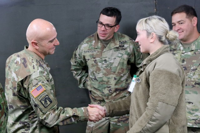 Command Sgt. Maj. Benjamin Jones, United States Army Pacific Command, Senior Enlisted Advisor, presents a coin for excellence to Sgt. Erica Earl, I Corps, 5th Mobile Public Affairs Detachment, Dec. 11, 2018 during his visit to Camp Higashi-Chitose on Hakkaido, Japan.Jones met with Northern Army Soldiers from the Japan Ground Self Defense Force, Soldiers from America's First Corps, and United States Army Japan during his visit in support of Exercise Yama Sakura 75.Yama Sakura underscores the strength of the close, long-standing relationship the United States has with Japan and the Japan Ground Self Defense Force. Yama Sakura demonstrates the continuing commitment to deepen our strong ties and mutual friendship.