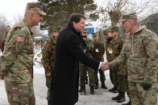 U.S. Army Pacific Commanding General, Gen. Robert Brown, and America's First Corps Commanding General, Lt. Gen. Gary Volesky, welcome U.S. Ambassador to Japan, Ambassador William Hagerty, to Camp Higashi-Chitose, Hokkaido, Japan, Dec 12, 2018, during Yama Sakura 75. Hagerty toured the camp and spoke about the significance of the alliance between America and Japan. Yama Sakura is a bilateral training exercise that strengthens the relationship between the U.S. Army and the Japan Ground Self Defense Force through the exchange of ideas, tactics and techniques. U.S. Army photo by Sgt. Erica Earl