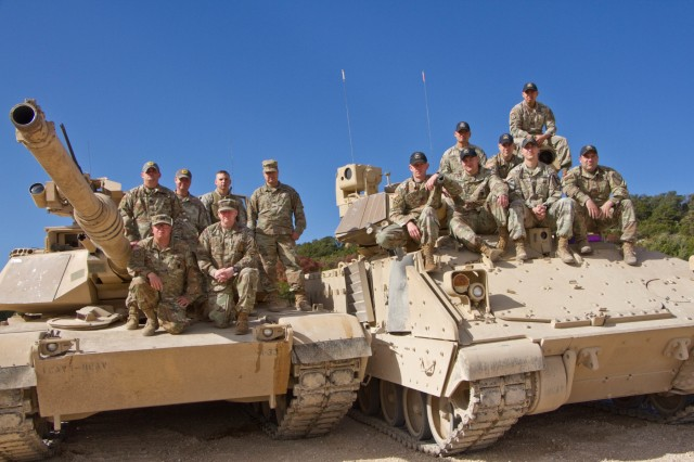 The master gunners for 2nd Armored Brigade Combat Team, 1st Cavalry Division: posing on the left are the master gunners for the M1A2 Abrams, on the right are the master gunners for the Bradley Infantry Fighting Vehicle. They are the technical and tactical experts for their weapon's platform. The master gunner advises the commander on everything related to the vehicle platform and weapon's system.