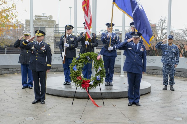 U.S. Army Brig. Gen. Brad Owens, director of joint staff for the South Carolina National Guard and U.S. Air Force Brig. Gen. Scott Lambe, assistant adjutant general for air, South Carolina National Guard, place a wreath at the South Carolina Armed Forces Memorial at the South Carolina State House, Dec. 10, 2018. The wreath is placed to honor the service men and women who served in the Armed Forces and made the ultimate sacrifice.