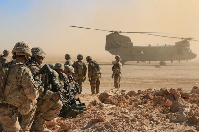Soldiers assigned to the 3rd Cavalry Regiment and deployed in support of Combined Joint Task Force -- Operation Inherent Resolve, await aerial extraction via CH-47 Chinook during an aerial response force live-fire training exercise in Iraq, Oct. 31, 2018. A number of training initiatives, collectively known as the Iraqi Air Enterprise, is underway across the Iraqi Air Force, Army Aviation, and Air Defense Commands. Continued growth towards Iraqi Security Forces self-sufficiency will permit the Coalition to adjust the role and number of Coalition forces in Iraq in response to changing support requirements of the ISF.