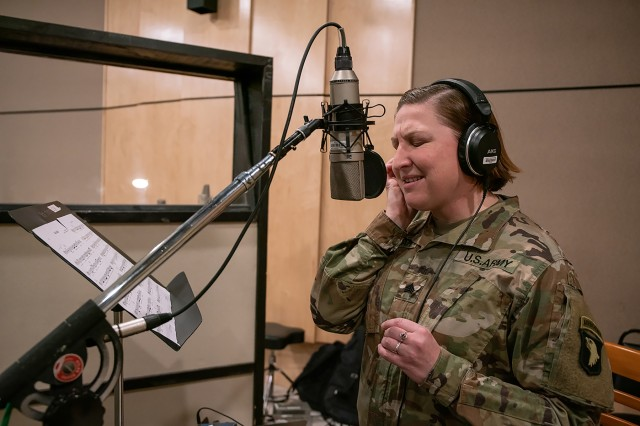 The Big 5 band helps pay tribute to Gold Star Families by recording a song written to honor them. Sgt. Katherine Bolcar, vocalist, 101st Airborne Division Air Assault Band sings 'Light of the Gold Star' at Columbia Studio A in Nashville on October 26. (US Army photo by Sgt. Patrick Kirby, 40th PAD)