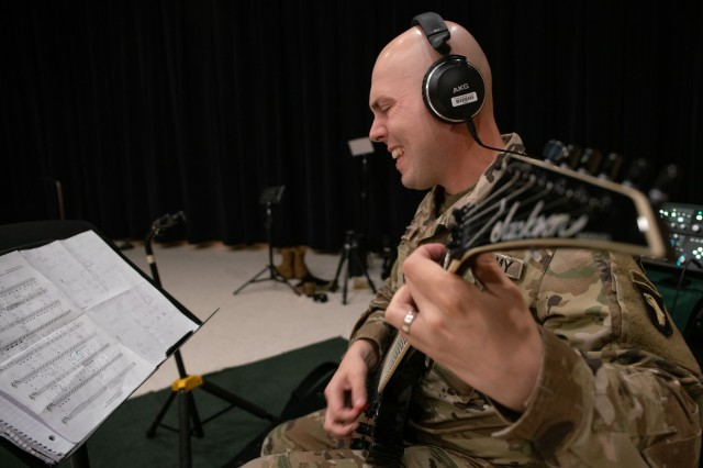 Spc. Shawn McGovern, guitarist, 101st Airborne Division Air Assault Band strums the guitar while recording 'Light of the Gold Star' at Columbia Studio A in Nashville on October 26. (US Army photo by Sgt. Patrick Kirby, 40th PAD)
