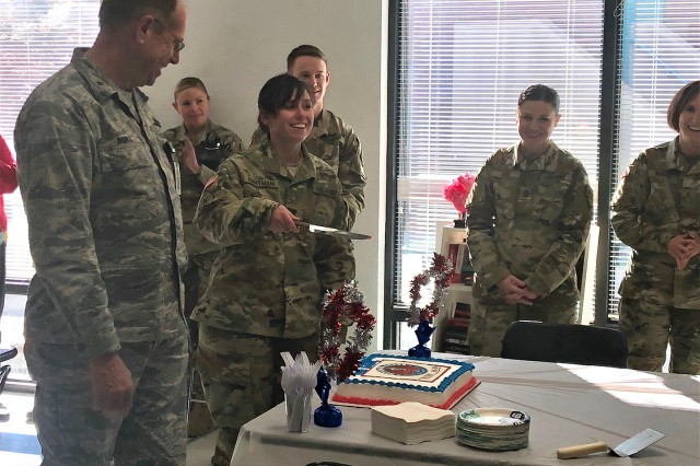 Spc. Ashley Hartman cuts the ceremonial birthday cake for the National Guard's 381st birthday alongside Nevada Adjutant General, Brig. Gen. William Burks, left. The Nevada National Guard Joint Forces Headquarters office celebrates the National Guard's birthday every year with the highest and most junior ranking members available as cake cutters.