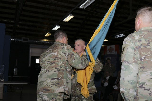 The Soldiers of the 100th Missile Defense Brigade (Ground-based Midcourse Defense) welcome new commander, Col. Chris M. Williams, during a change of command at Peterson Air Force Base in Colorado Springs Dec. 7, 2018. Col Kevin R. Kick relinquished command of the nation's only missile defense brigade after more than two years in command. (U.S. Army National Guard photo by Staff Sgt. Zachary Sheely)
