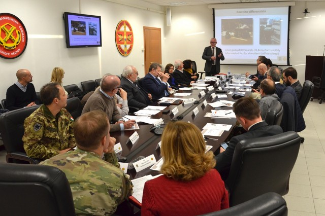 U.S. Army garrison Italy Housing Director Lewis Smith shares waste collection and recycling information provided to American families living in Italy.   More than 20 mayors from cities and towns around the garrison for a third Mayors Summit on Dec. 11, 2018, to discuss community concerns and share ideas to better integrate Soldiers and their families into life in Italy. The first summit was held in March.  (U.S. Army photo by Laura Kreider)