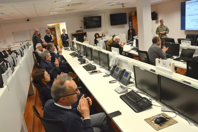 USAG Italy Garrison Commander Col. Erik M. Berdy explains the purpose of the emergency operations center.  More than 20 mayors from cities and towns around the garrison for a third Mayors Summit on Dec. 11, 2018, to discuss community concerns and share ideas to better integrate Soldiers and their families into life in Italy. The first summit was held in March.  (U.S. Army photo by Laura Kreider)