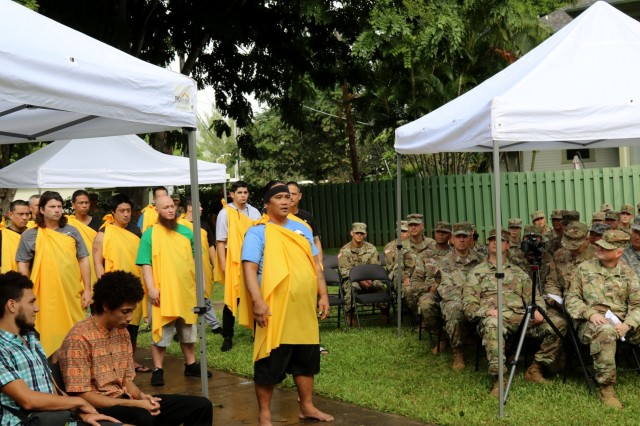 FORT SHAFTER, Hawaii - Wayne Ka'ahanui leads Kanaka Oiwi in the Oli, the traditional Hawaiian asking of permission, and the Ha'a Koa, the traditional Hawaiian bent-knee dance of the warrior, at the promotion of his cousin, U.S. Army Reserve Sgt. 1st Class Justin Ka'ahanui, a civil affairs noncommissioned officer and medic with the 322nd Civil Affairs Brigade. The promotion takes place at Palm Circle, the same place their grandfather Henry Ka'ahanui Sr. enlisted to serve in the first Hawaiian Regiment during World War I at the bequest of Hawaii's Queen Lilioukalani, as well as the same place their uncle Henry Ka'ahanui Jr. enlisted to serve in World War II. (Photo by Crista Mary Mack, 9th Mission Support Command)