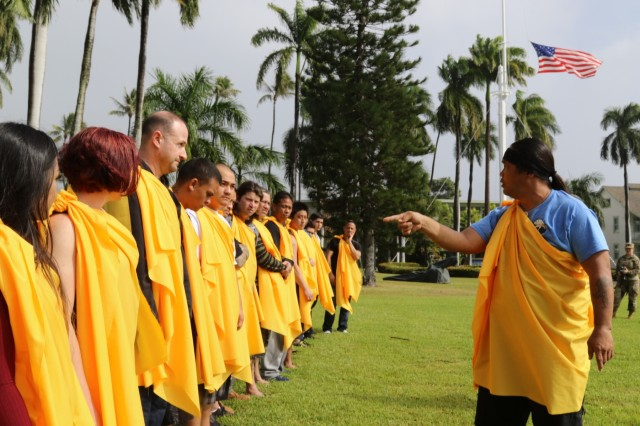 FORT SHAFTER, Hawaii - Wayne Ka'ahanui prepares the Kanaka Oiwi, a group of traditional Hawaiian cultural practioners for the Oli, the traditional Hawaiian asking of permission, and the Ha'a Koa, the traditional Hawaiian bent-knee dance of the warrior, at the promotion of his cousin, U.S. Army Reserve Sgt. 1st Class Justin Ka'ahanui, a civil affairs noncommissioned officer and medic with the 322nd Civil Affairs Brigade. The promotion takes place at Palm Circle, the same place their grandfather Henry Ka'ahanui Sr. enlisted to serve in the first Hawaiian Regiment during World War I at the bequest of Hawaii's Queen Lilioukalani, as well as the same place their uncle Henry Ka'ahanui Jr. enlisted to serve in World War II. (Photo by Crista Mary Mack, 9th Mission Support Command)