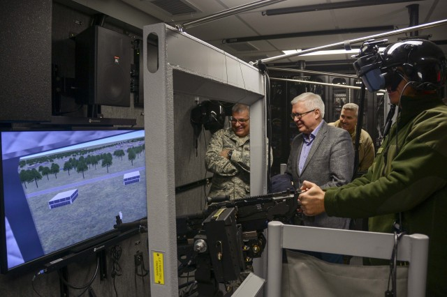 Lithuania's Vice Minister of Defense, Vytautas Umbrasas, and other senior officials visited the Pennsylvania National Guard's Eastern Army National Guard Aviation Training Site (EAATS) here Dec. 5. Col. Alvydas Siuparis, the embassy defense attache, tried out a simulator while Umbrasas and Maj. Gen. Anthony Carrelli, Pennsylvania's adjutant general, and Maj. Gen. Timothy Hilty, the Pennsylvania National Guard's assistant adjutant general.