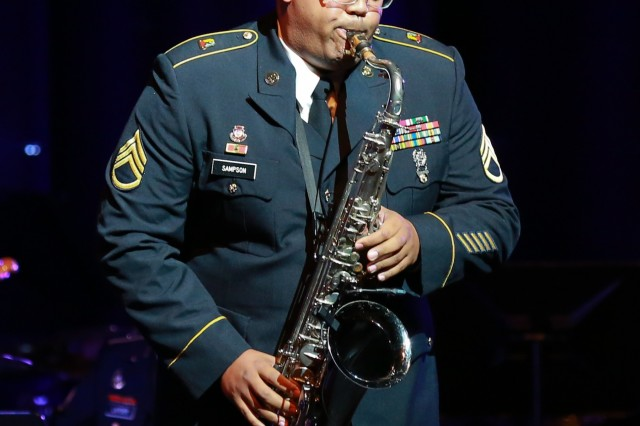 FORT BENNING, Ga. (Dec. 13, 2018) -- In this file photo from the Maneuver Center of Excellence Band's holiday concert at the Columbus, Georgia, RiverCenter for the Performing Arts, Staff Sgt. Reginald Sampson, operations noncommissioned officer in charge for the MCoE Band, plays the saxaphone. The MCoE Band is inviting members of the Chattahoochee Valley communities to their annual holiday concert Dec. 15, 2018, at the RiverCenter for the Performing Arts in downtown Columbus, Georgia. (U.S. Army file photo by Markeith Horace, Maneuver Center of Excellence, Fort Benning Public Affairs)