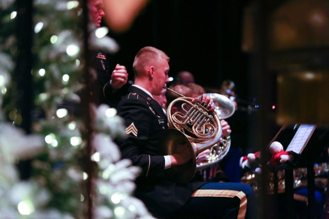 FORT BENNING, Ga. (Dec. 13, 2018) - In this file photo from 2017, band members play holiday music during the holiday concert in downtown Columbus, Georgia. The MCoE Band is inviting members of the Chattahoochee Valley communities to their annual holiday concert Dec. 15, 2018, at the RiverCenter for the Performing Arts in downtown Columbus, Georgia. (U.S. Army photo by Markeith Horace, Maneuver Center of Excellence, Fort Benning Public Affairs)