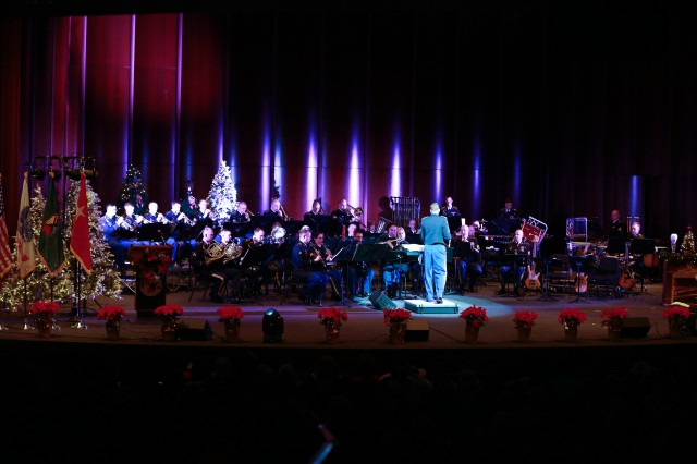 FORT BENNING, Ga. (Dec. 13, 2018) - In this file photo from 2017, Capt. Aaron Morris, commander of the Maneuver Center of Excellence Band, conducts the holiday concert in downtown Columbus, Georgia. The MCoE Band is inviting members of the Chattahoochee Valley communities to their annual holiday concert Dec. 15, 2018, at the RiverCenter for the Performing Arts in downtown Columbus, Georgia. (U.S. Army photo by Markeith Horace, Maneuver Center of Excellence, Fort Benning Public Affairs)