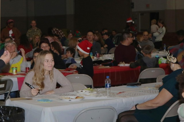 Soldiers and families of the Headquarters and Headquarters Battalion (rear)(provisional),XVIII Airborne Corps are playing a competitive game of bingo to win a grand prize Dec. 7, 2018 during the unit's holiday party at Fort Bragg, N.C. The event brought soldiers and families together from across the unit to raise morale during the holiday season. (U.S. Army photo by Pvt. Nathaniel Gayle / 22nd Mobile Public Affairs Detachment)