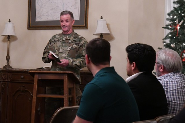 Maj. Gen. Walter E. Piatt, 10th Mountain Division (LI) and Fort Drum commander, read his own published and unpublished poems Dec. 11 during the monthly Maj. Gen. Fox Conner Professional Reading Group at LeRay Mansion. This session focused on war poetry and featured readings from guest speaker, Paul David Adkins, a career counselor at Fort Drum Soldier for Life-Transition Assistance Program and retired noncommissioned officer with 2nd Brigade Combat Team, 10th Mountain Division (LI). Jefferson Community College students also attended and shared poems written for their History 261 capstone project in the Dialogues of Honor and Sacrifice course. This course is funded by a National Endowment for the Humanities grant and was designed for veterans to explore the concept of honor and sacrifice through the prism of combat and conflict. (Photo by Mike Strasser, Fort Drum Garrison Public Affairs)