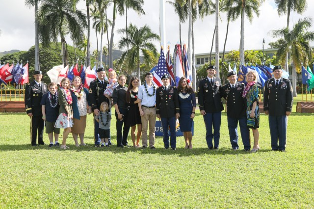 Soldiers, family and friends gather together during USARPAC's Celebration of Service ceremony, Nov. 12, 2018 at historic Palm Circle on Fort Shafter, Hawaii. The ceremony recognizes Soldiers for exceptional service to U.S. Army Pacific and the nation as they prepare to transition into new careers.