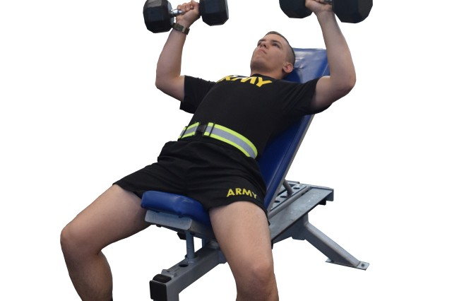 Lie back on a bench with a 15- to 30-degree incline. Grip the dumbbells with hands shoulder width apart and palms facing away.