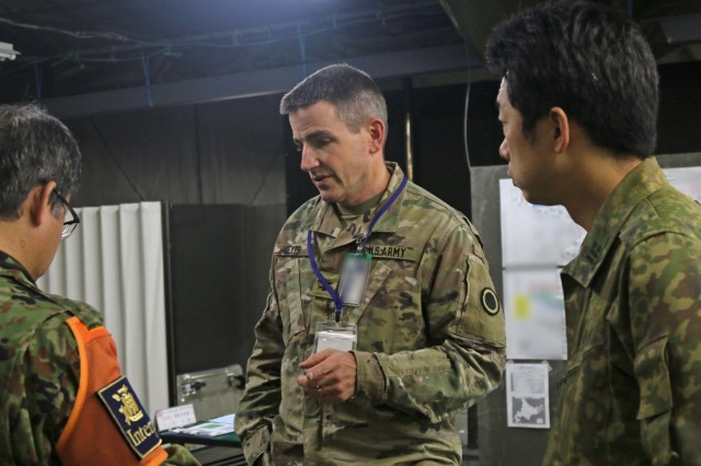 America's First Corps and Japan Northern Army Soldiers work together with the help of interpreters to communicate ideas and strategies during Yama Sakura 75 at Camp Higashi-Chitose, Hokkaido, Japan, Dec. 13, 2018. Over the course of the week-long bilateral exercise, the U.S. Army and the Japan Ground Self Defense Force are working together in a simulation of the defense of Japan to strengthen the alliance and the capabilities of both countries' forces. Multiple sections are participating in the exercise, including signal, clerical, legal, medical and intelligence personnel. U.S. Army photo by Sgt. Erica Earl