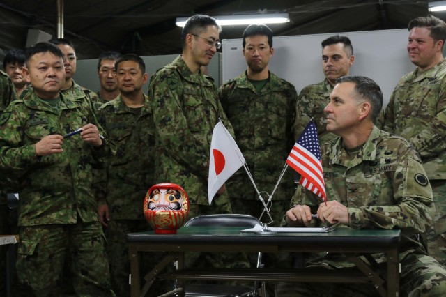 Col. Mikio Takeshima, M.D., Northern Army Headquarters surgeon, Japan Ground Self Defense Force (left) and Col Robert Forsten, D.O., America's First Corps surgeon, prepare to sign a medical support agreement during Yama Sakura 75 at Camp Higashi-Chitose, Hokkaido, Japan, Dec. 10, 2018.  This agreement allows mutual medical support between the forces as needed, including patient evacuation, casualty treatment and patient logistics, during the course of the exercise. Yama Sakura is a bilateral exercise that combines the capabilities of the U.S. Army and the JGSDF and solidifies the working relationship between the forces. U.S. Army photo by Sgt. Erica Earl