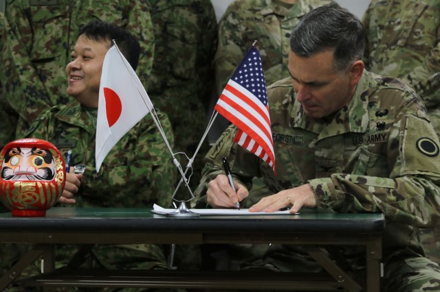Col Robert Forsten, D.O., America's First Corps surgeon (right) signs a medical support agreement with Col.  Mikio Takeshima, M.D., Northern Army Headquarters surgeon, Japan Ground Self Defense Force during Yama Sakura 75 at Camp Higashi-Chitose, Hokkaido, Japan, Dec. 10, 2018.  This agreement allows mutual medical support between the forces as needed, including patient evacuation, casualty treatment and patient logistics, during the course of the exercise. Yama Sakura is a bilateral exercise that combines the capabilities of the U.S. Army and the JGSDF and solidifies the working relationship between the forces. U.S. Army photo by Sgt. Erica Earl