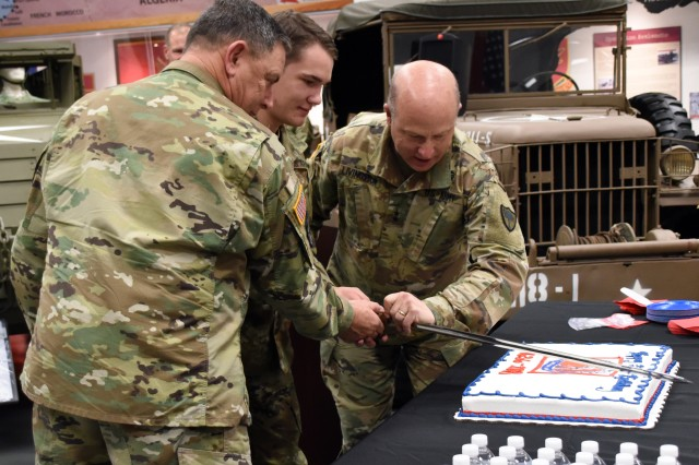 The South Carolina National Guard recognized the National Guard's 382nd birthday with a cake-cutting ceremony Dec. 13, 2018, at the South Carolina Military Museum in Columbia, South Carolina. Pvt. Jackson Sulser, 1-178th Field Artillery Headquarters and Headquarters Battery signal support specialist, 17, and Sgt. 1st Class Tommy Morgan, 4-118th Combined Arms Battalion Headquarters and Headquarters Company electronic warfare sergeant, 59, cut the cake and U.S. Army Maj. Gen. Robert E. Livingston, the adjutant general for South Carolina, presided over the ceremony.