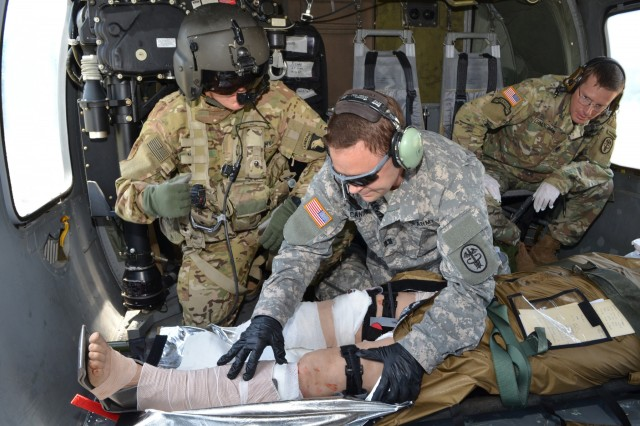 Capt. Curt Canine, CRDAMC Emergency Medicine resident, provides enroute care to a casualty during a Combat Casualty Care Tactical exercise. The three-day exercise simulated an austere environment and encompassed the full gamut of combat casualty care to give residents training for deployments.