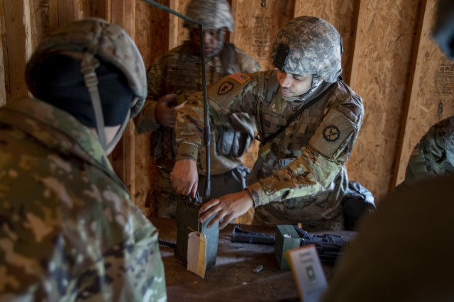 U.S. Army Reserve Soldiers from the 535th Military Police Battalion operate a Single Channel Ground and Airborne Radio System during a field training exercise at Camp Butner, N.C., Dec. 7, 2018.