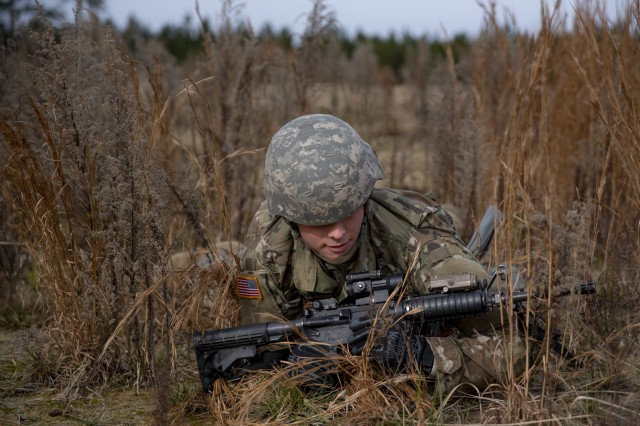 A U.S. Army Reserve military police Soldier from the 88th Military Police Company, executes a low crawl at Camp Butner, N.C., Dec. 8, 2018.