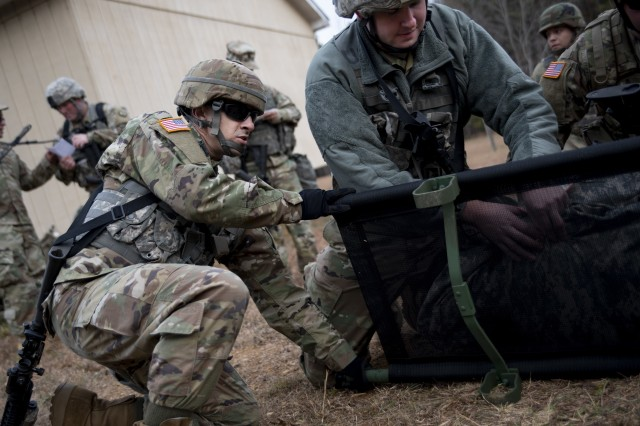 U.S. Army Reserve Soldiers from the 535th Military Police Battalion perform first aid during a field train exercise at Camp Butner, N.C., Dec. 7, 2018.