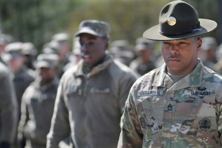 An advanced individual training platoon sergeant marches the Quartermaster School troops, March 15, 2018, at Fort Lee, Va. He is among the first wave of installation advanced individual training platoon sergeants who attended the Drill Sergeant Academy course that converted them to drill sergeant status.  Four graduates on March 12 became the first NCOs to don campaign hats since 2008 when a new Army policy replaced drill sergeants with AIT platoon sergeants.