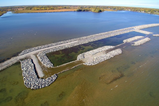 Aerial view of the Braddock Bay barrier beach in Greece, NY, October 16, 2016. The U.S. Army Corps of Engineers, Buffalo District's project to restore the Braddock Bay ecosystem in Greece, NY was completed on November 15, 2018. The project tackled two major issues affecting the Braddock Bay ecosystem: the loss of wetland habitat caused by wave driven erosion, and degradation of the existing habitat due to invasive species. (Photo provided by Courtesy Asset)